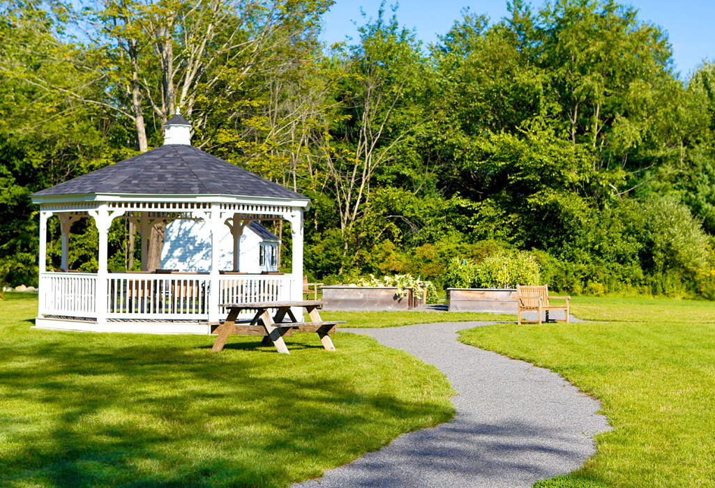Picnic area and gazebo for outdoor activities at RiverWoods Exeter in Exeter, New Hampshire.