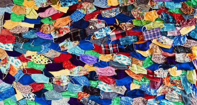 Hundreds of colorful clothe face masks sewn by RiverWoods residents and staff