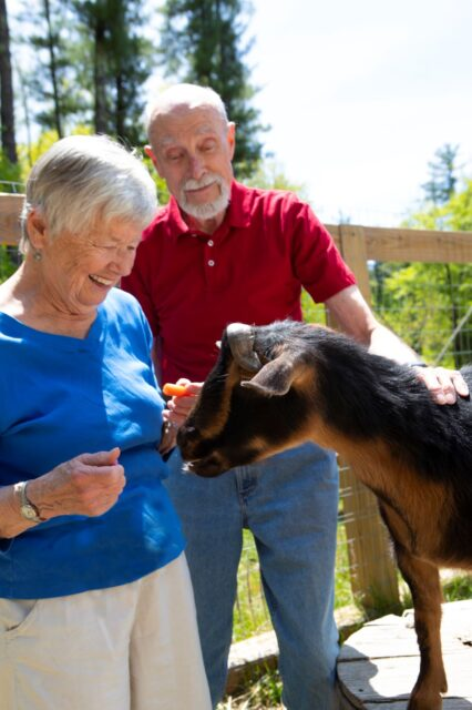 RiverWoods residents with Nigerian goats